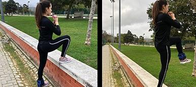 Rapariga a fazer step up com pesos, exercício de fitness para tonificar os membros inferiores | Holmes Place