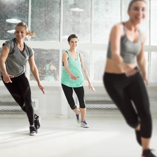 indoor gym class fitness group women exercise | Holmes Place