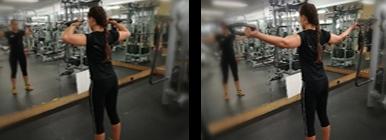 Mulher a fazer bíceps no cabo | Fitness | Holmes Place