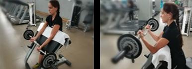 Mulher a fazer bíceps no banco | Fitness | Holmes Place