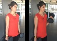 Mulher a fazer bicep curl com halteres | Fitness | Holmes Place