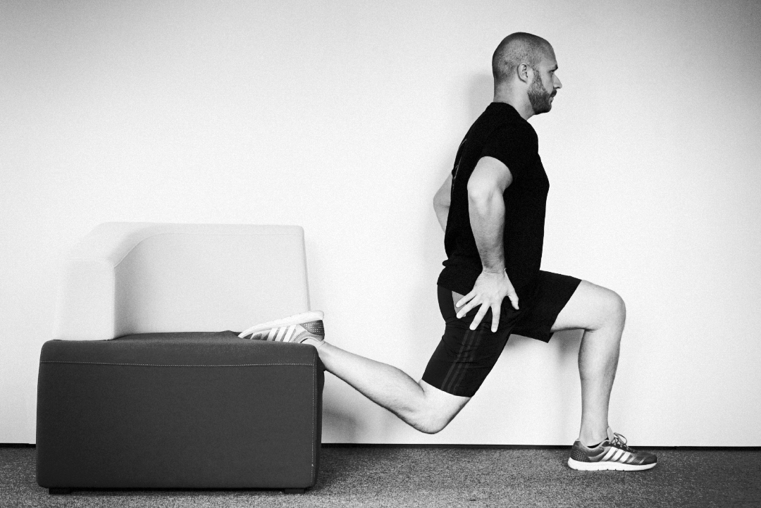 Holmes Place | man exercise fitness on couch