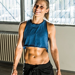 Holmes Place | Woman in the Gym with Abs