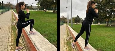 Rapariga a fazer step up sem pesos, exercício de fitness para tonificar os membros inferiores | Holmes Place