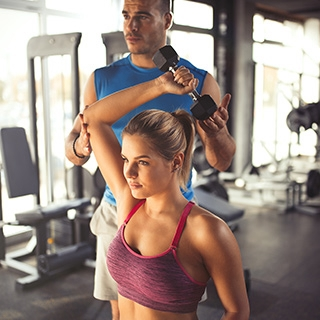 Holmes Place | Woman Exercising with Personal Trainer