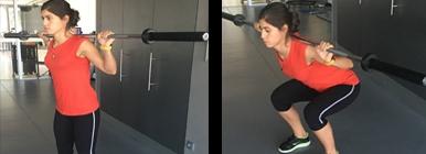Mulher a fazer agachamento com barra | Musculação | Holmes Place