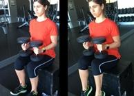 Mulher a fazer calf raise sentada | Musculação | Holmes Place