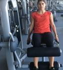 Mulher a fazer leg curl | Musculação | Holmes Place