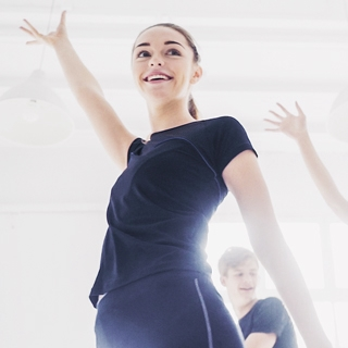woman laugh indoor workout sunny class | Holmes Place