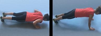 Mulher a fazer push ups | Musculação | Holmes Place