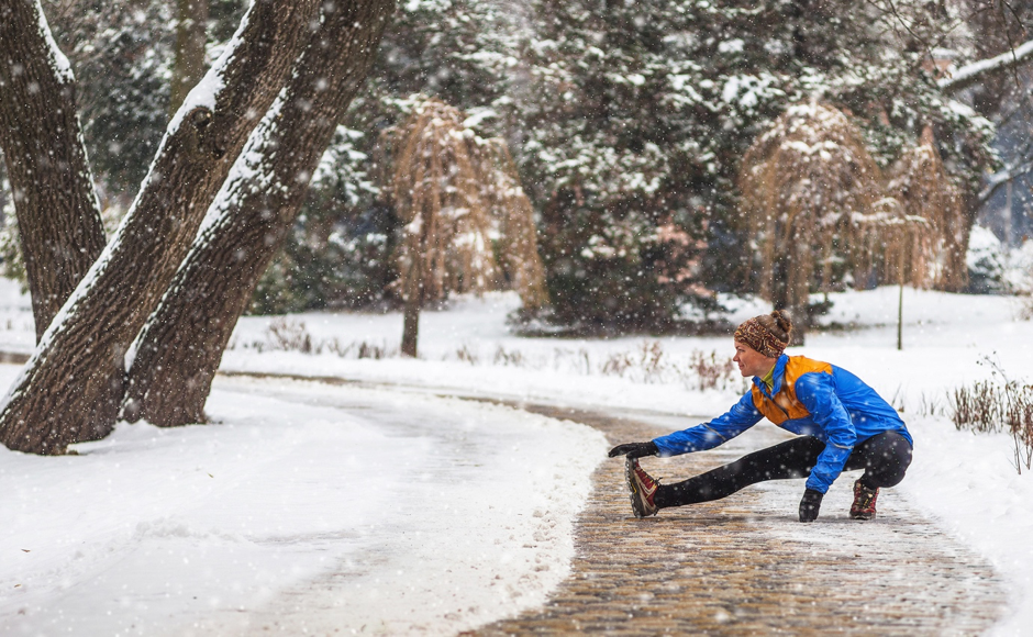 Holmes Place | Woman stretching outdoor winter