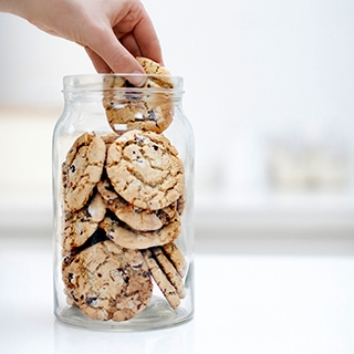 Holmes Place | hand in cookie jar