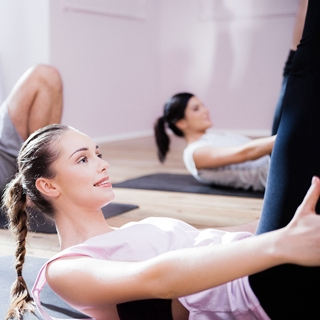 group class woman exercise group indoor gym pilates abs | Holmes Place