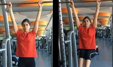 Mulher a fazer hanging leg raise | Musculação | Holmes Place